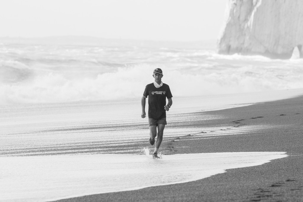 Dan Williams running at Durdle Door Beach